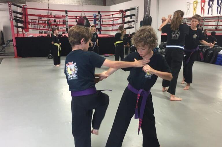 Kids practicing martial arts moves