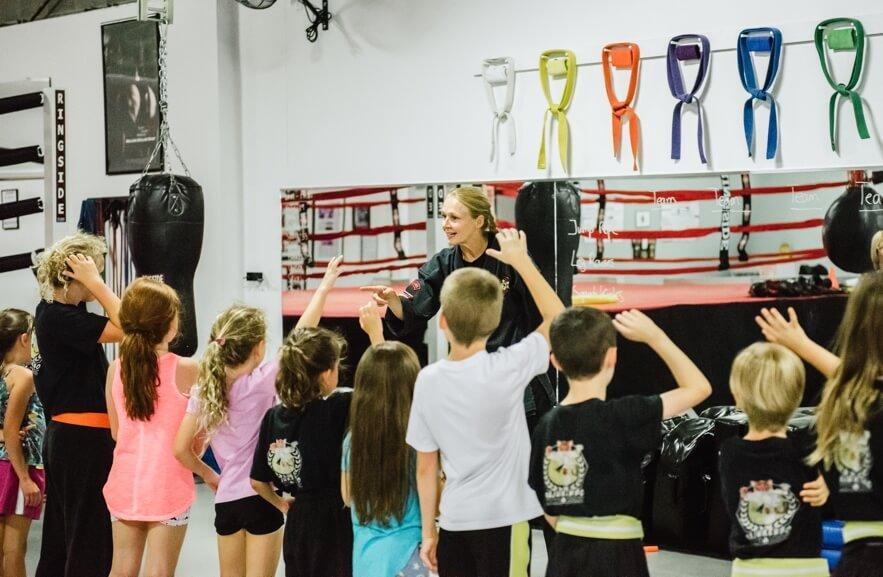 Teaching kids martial arts class