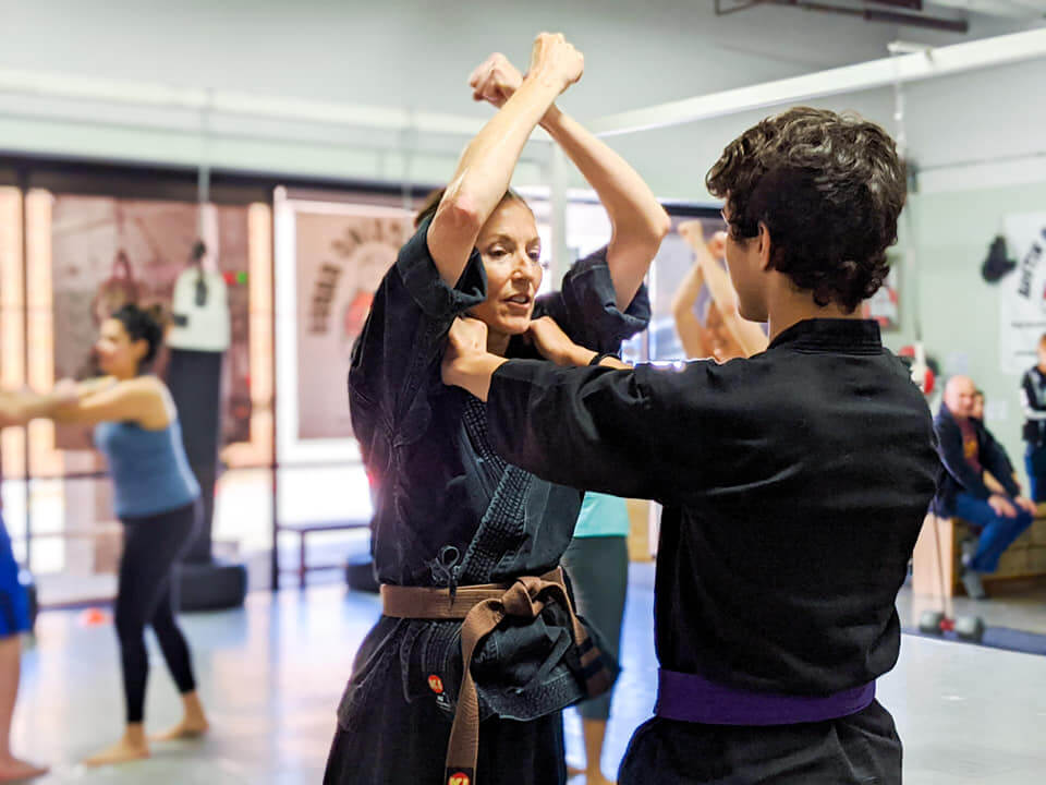 Woman leading martial arts class at Austin Boxing Babes